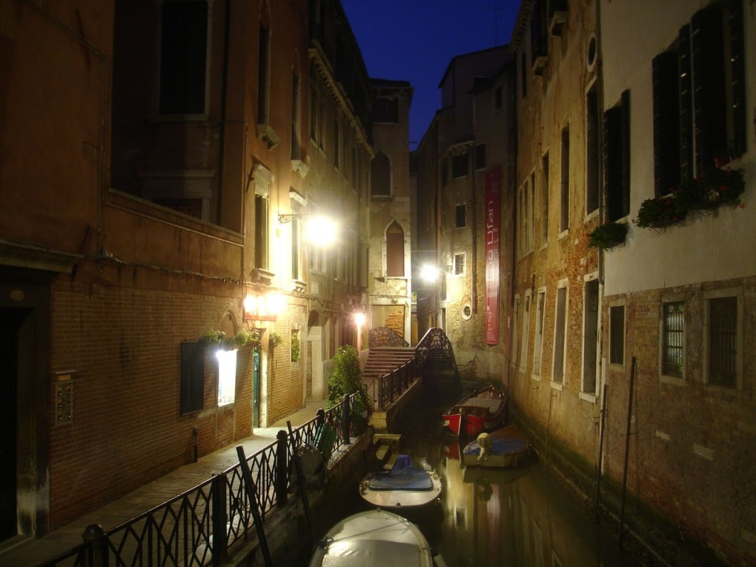 A nighttime view of a canal in Venice