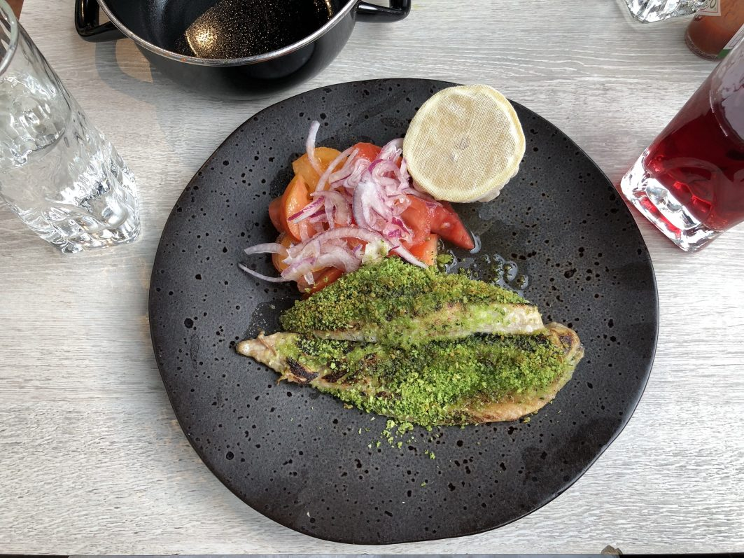 Herb-crusted fish at fish! restaurant in London