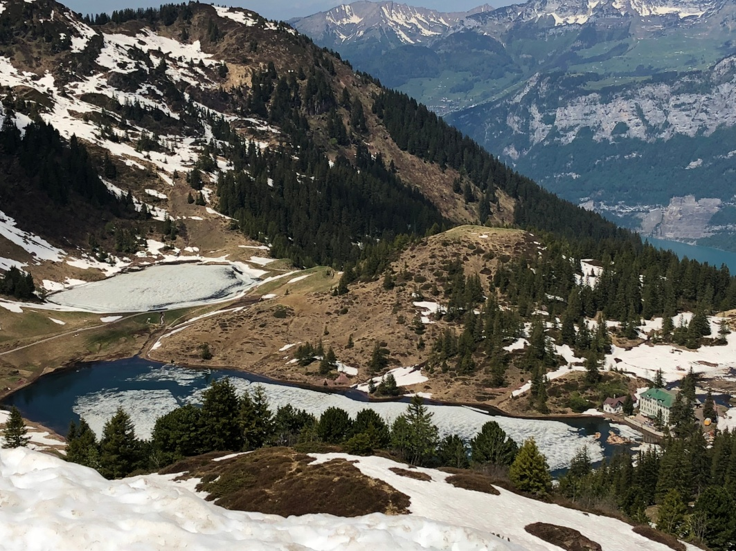 A view of the ski lodge with two smaller lakes in the mountains