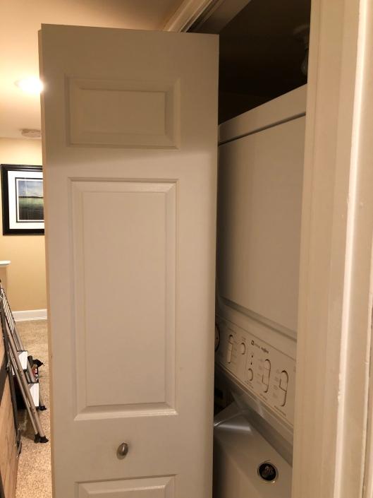 The original bi-fold door blocking most of our narrow hallway when opened